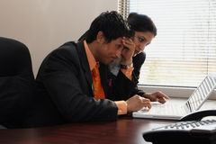 Squadra di affari che sembra Stumped Fotografia Stock Libera da Diritti
