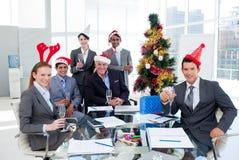 Squadra di affari che tosta con Champagne Fotografia Stock Libera da Diritti