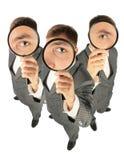 Squadra di affari con il collage dei magnifiers immagini stock libere da diritti