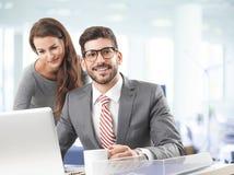 Squadra di affari con il computer portatile Immagine Stock Libera da Diritti