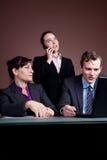 Squadra di affari e un phonecall Fotografia Stock