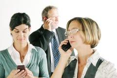 Squadra di affari sul telefono immagini stock libere da diritti
