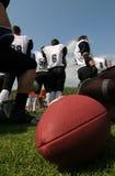 Squadra di football americano Fotografia Stock