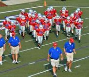 Squadra di football americano e vetture della gioventù Fotografie Stock