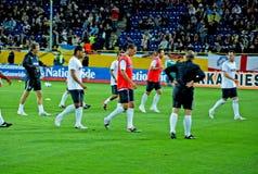Squadra di football americano inglese che riscalda Fotografie Stock Libere da Diritti