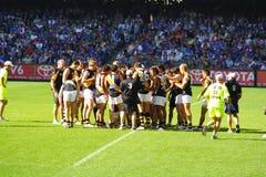 Squadra di Richmond di gioco del calcio di AFL fotografia stock libera da diritti