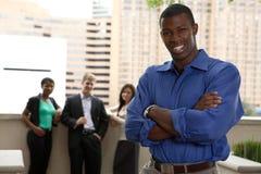 Squadra esterna con l'Africano Immagini Stock Libere da Diritti