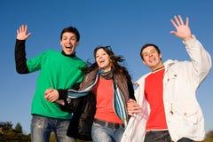 Squadra felice dei giovani di risata Fotografia Stock