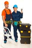 Squadra felice di idraulici Fotografia Stock