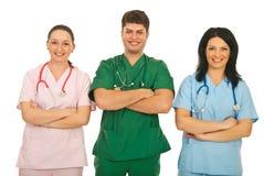 Squadra felice di medici Immagine Stock