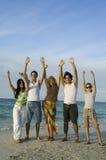 Squadra felice sulla spiaggia Fotografia Stock