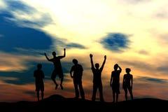 Squadra felice - tramonto Immagine Stock