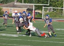 Squadre di football americano della scuola secondaria Fotografie Stock Libere da Diritti