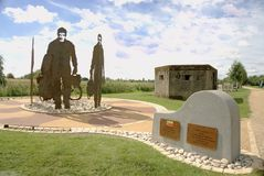 47 Squadron memorial. This memorial depicting members of 47 squadron was unveiled the commemorate the 100th year of the squadron. It is made from metal panels Stock Photos