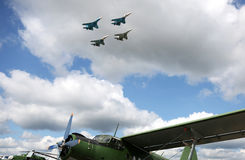 Squadron of military airplanes flying in the sky Stock Image