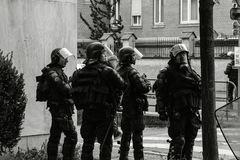 Squadron of police gerdarms officers secruing street in Strasbourg. Strasbourg, France - Apr 28, 2019: Squadron of police gerdarms officers secruing entrance to royalty free stock image