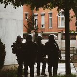 Squadron of police gerdarms officers secruing street in Strasbourg. Strasbourg, France - Apr 28, 2019: Squadron of four police gerdarms officers secruing royalty free stock photo