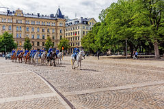 Squadron returns to barracks. After changing of the guard at the Royal Palace. The Royal Guard was established in 1523 and continuously guards the Royal Palace Royalty Free Stock Image