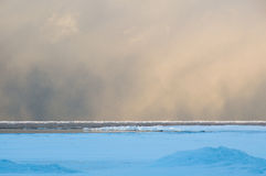 Squall snow clouds at dawn over Lake Huron landscape stock image