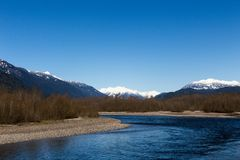 The Squamish River and snow-peaked Coast mountains in the Brackendale Eagles Provincial Park. In April, British Columbia, Canada stock photo