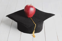 Square academic hat. With apple Stock Images