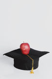 Square academic hat. With apple Stock Image