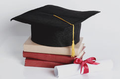 Square academic hat. Graduation. Square academic hat with books Royalty Free Stock Image