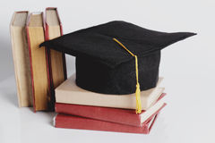 Square academic hat. Graduation. Square academic hat with books Stock Photography