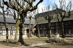 Square Aitre de Saint Maclou in Rouen, France. Courtyard in Aitre de Saint Maclou in Rouen, ancient graveyard of victims of epidemic. France, Normandy Royalty Free Stock Images