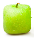 Square apple on a white background. Royalty Free Stock Photos