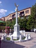 Square in Arandjelovac, Serbia. Square of freedom in Arandjelovac, Serbia on sunny day with blue sky and monument to wariors from 1912-1915 royalty free stock photo