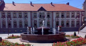 Square in Arandjelovac, Serbia. On sunny day with blue sky and fountain and historic building behind the fountain royalty free stock photography
