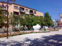 Square in Arandjelovac, Serbia. On sunny day with blue sky with white sculpture royalty free stock images