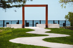 Square arc over the path to the lakefront Stock Images