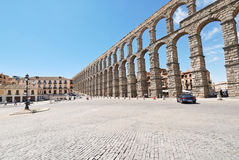 Square Azoguejo with Aqueduct of Segovia. SEGOVIA, SPAIN - JULY 10, 2011: Square Azoguejo with Aqueduct of Segovia. It consists of about 25000 granite blocks royalty free stock photo