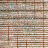 Square background from checkered brown wool fabric Stock Image