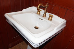 Square basin and faucet bronze in vintage style Stock Photos
