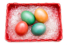 Square basket with colored eggs from above Royalty Free Stock Photo
