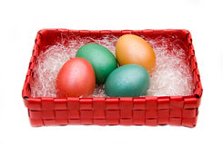 Square basket with colored eggs Stock Photos