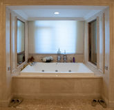 Square Bathtub. A white Square Bathtub.Surround with yellow marble royalty free stock images