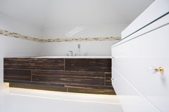 Square bathtub inside bright bathroom Stock Photo