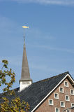 Square belfry with fish weather vane Stock Photo