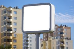 Square billboard in the city, blank template. Smaller than bulletin board, larger than poster. High impact outdoor advertising royalty free stock image