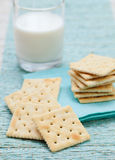 Square biscuit cracker with fresh milk in glass Royalty Free Stock Images