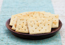 Square biscuit cracker in a wooden bowl Royalty Free Stock Photography