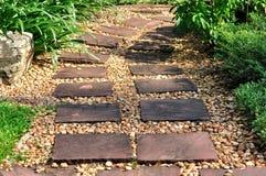 Square block walk way through garden Royalty Free Stock Image