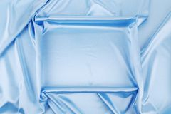 Square in blue fabric. Stock Photography