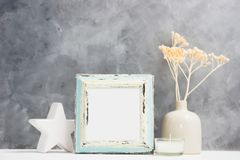 Square blue Photo frame mock up with dry beige plants in vase, ceramic decor on shelf. Scandinavian style Royalty Free Stock Image