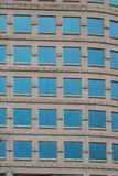 Square Blue Windows on Ornate Stone Building Royalty Free Stock Images
