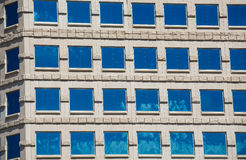 Square Blue Windows in Stone Building Royalty Free Stock Images